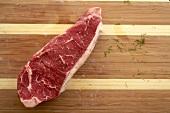 Raw Top Sirloin Steak on a Cutting Board
