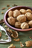 Bowl of Walnuts with Nut Cracker and Walnut Shells