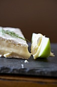 A Wedge of Brie with a Granny Smith Apple Slice