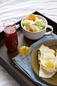 A Breakfast Tray with Fresh Melon, Eggs and Blood Orange Juice