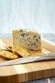 Gorgonzola Piccanta Cheese with Crackers on a Cheese Board