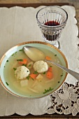 Bowl of Matzoh Ball Soup with Wine