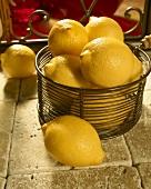 Wire Basket of Lemons on Italian Tiles