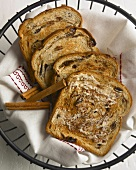 Buttered Cinnamon Raisin Toast in a Wire Basket with Cinnamon Sticks