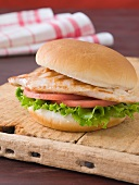 Grilled Chicken Sandwich with Lettuce and Tomato on a Bun
