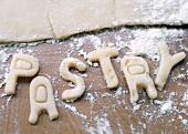 Schrift Pastry aus Blätterteig