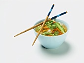 Small Bowl of Asian Vegetable Soup with Chopsticks