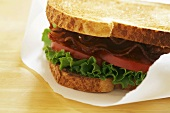 BLT sandwich in greaseproof paper