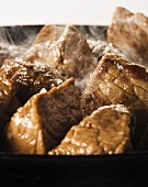 Beef being fried in a pan (close up)