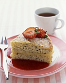 A piece of poppy seed cake with fresh strawberries