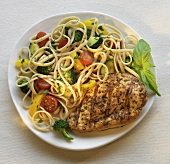 Grilled Chicken Breast with Pasta Primavera on a Plate