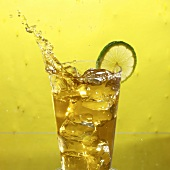 Glass of Iced Tea with Lime, Splashing