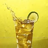 Glass of Iced Tea with Lime, Splashing