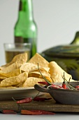Tortilla Chips with Red Chili Peppers, Bottle and Glass of Beer