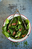 Spinach Salad with Warm Bacon Dressing in Serving Bowl, Overhead
