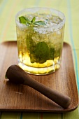 Mint Julep made with Kentucky Bourbon in a Glass on a Wooden Tray