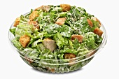 Bowl of Chicken Caesar Salad on a White Background