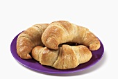 Three Crescent Rolls on a Plate, White Background