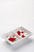 Candy Hearts in a Divided Dish; White Background
