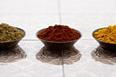 Three Small Bowls of Ground Spices