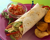 A Veggie Burrito with Chips and Salsa