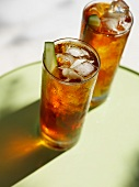 Two Tall Glasses of Pimm's with Cucumber Garnish