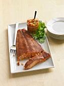 Grilled Salmon Fillet on a Platter; Stack of Serving Plates