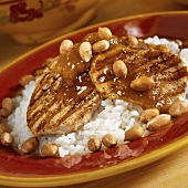 Grilled Pork Medallion Over Rice with Chutney and Peanuts
