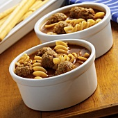 Two Bowls of Meatball Soup with Fusilli Pasta