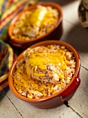 Chicken Breast Over Corn and Rice with Melted Cheese