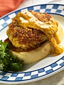A Crab Cake on Texas Toast with Red Pepper Sauce