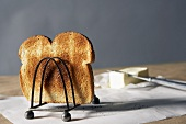 Piece of Toasted Bread in a Toast Rack, Butter