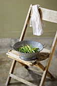 Colander of Green and Wax Beans on a Chair
