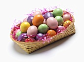 Basket of Candy Easter Eggs on a White Background