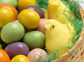 Close Up of an Easter Basket with Candy Eggs and Peeps
