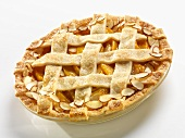 Whole Peach Almond Pie with a Lattice Top on a White Background