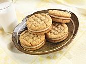 Peanut Butter Sandwich Cookies on a Plate, Glass of Milk
