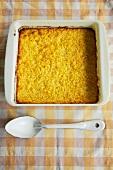 Corn Pudding in Baking Dish, Spoon