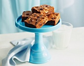 Chocolate Chip Walnut Brownies on a Blue Pedestal Dish