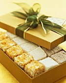 Various Marshmallow Candy in a Gold Gift Box with Ribbon, Opened