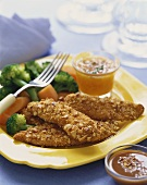 Nut Crusted Chicken Tenders on a Plate with Carrots and Broccoli, Dipping Sauce