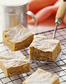 Macadamia Nut Bars Dusted with Powdered Sugar on a Cooling Rack