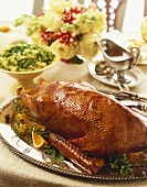 Whole Roasted Goose on a Silver Platter, Side Dish and Gravy Boat