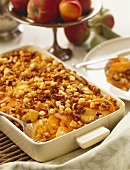 Sweet Potato and Apple Gratin in a Baking Dish with Serving Spoon