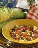Bowl of Lobster Stew, Spoons and Corn on the Cob