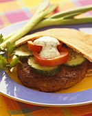 Lamb Burger with Cucumber, Tomato and Yogurt Sauce in Pita Bread