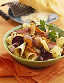Bowl of Wide Noodles with Roasted Vegetables, Parsley Garnish