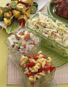 Three Assorted Summer Salads in Glass Containers