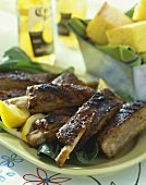 Platter of Grilled Ribs, Corn Bread and Corona