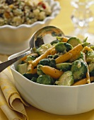 Brussels Sprout and Carrot Side Dish in a Serving Bowl with Serving Spoon
